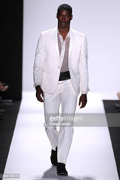 A model walks the runway at Carmen Marc Valvo during MercedesBenz Fashion Week Spring 2015 at The Theatre at Lincoln Center on September 5 2014 in...