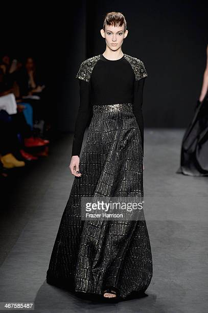 A model walks the runway at Carmen Marc Valvo fashion show during MercedesBenz Fashion Week Fall 2014 at The Salon at Lincoln Center on February 7...