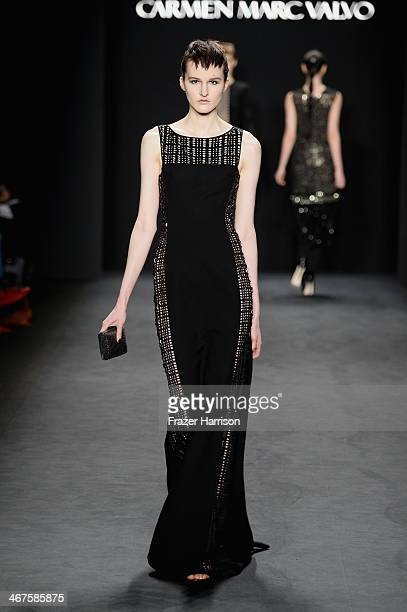 Model walks the runway at Carmen Marc Valvo fashion show during Mercedes-Benz Fashion Week Fall 2014 at The Salon at Lincoln Center on February 7,...