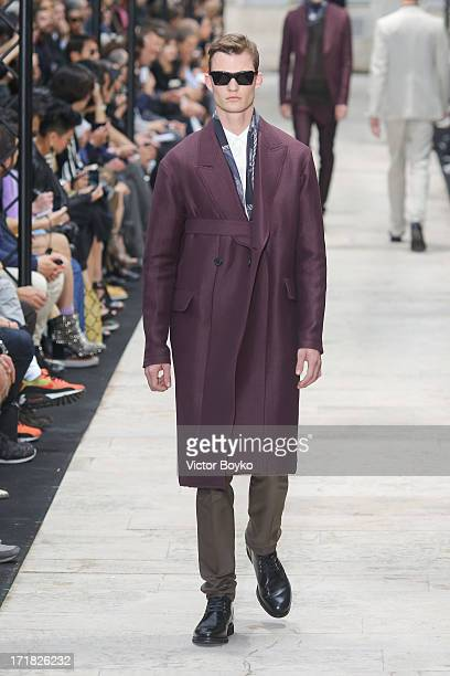 A model walks the runway at Cerruti Menswear Spring/Summer 2014 Show As Part Of The Paris Fashion Week on June 28 2013 in Paris France