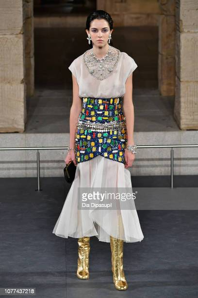 A model walks the runway at Chanel Metiers D'Art 2018/19 Show at The Metropolitan Museum of Art on December 04 2018 in New York City