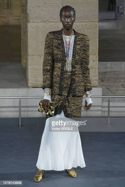 A model walks the runway at Chanel Metiers D'Art 2018/2019 Fashion show at The Metropolitan Museum of Art on December 04 2018 in New York City