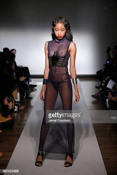 A model walks the runway at Chromat AW14 Runway show during MADE Fashion Week Fall 2014 at The Standard Hotel on February 6 2014 in New York City