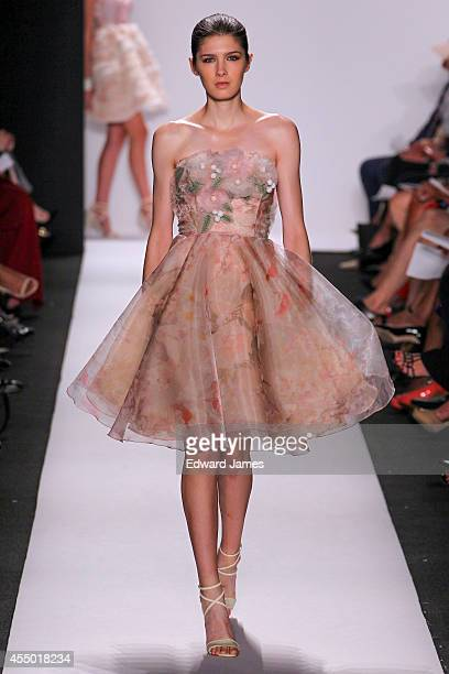 A model walks the runway at Dennis Basso during MercedesBenz Fashion Week Spring 2015 at The Theatre at Lincoln Center on September 8 2014 in New...