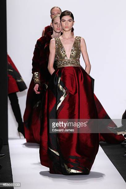 A model walks the runway at Dennis Basso during MercedesBenz Fashion Week Fall 2014 at The Theatre at Lincoln Center on February 10 2014 in New York...