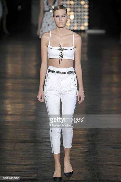 Model walks the runway at Diesel Black Gold during Mercedes-Benz Fashion Week Spring 2015 at Skylight at Moynihan Station on September 9, 2014 in New...