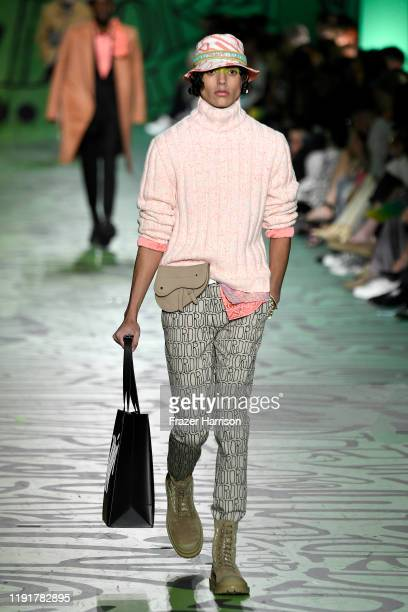 A model walks the runway at Dior Men's PreFall 2020 Runway Show on December 03 2019 in Miami Florida