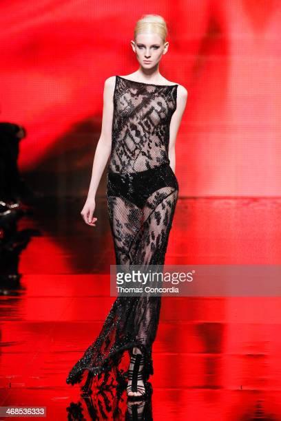 A model walks the runway at Donna Karan New York 30th Anniversary during MercedesBenz Fashion Week Fall 2014 at 23 Wall Street on February 10 2014 in...