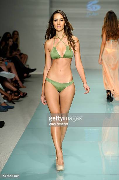 A model walks the runway at Du Aqua Runway Show during Art Hearts Fashion Miami Swim Week Presented by AIDS Healthcare Foundation at Collins Park on...