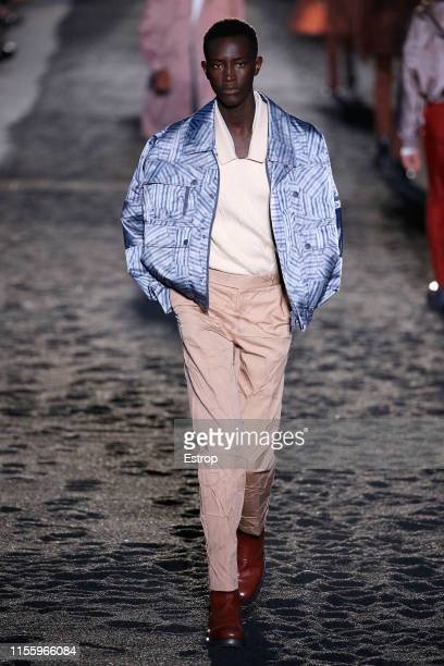 Model walks the runway at Ermenegildo Zegna fashion show at Aree Ex Falck during Milan Men's Fashion Week Spring/Summer 2020 on June 14, 2019 in...
