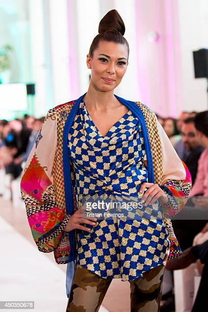 A model walks the runway at Fashion Parade a special event to celebrate the fashion designers of Pakistan at The Orangery on June 9 2014 in London...
