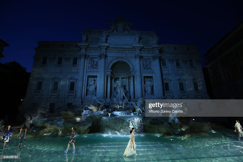 A model walks the runway at Fendi Roma 90 Years Anniversary fashion show at Fontana di Trevi on July 7, 2016 in Rome, Italy.