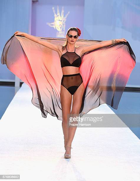 A model walks the runway at Filthy Haanz 2017 Collection during SwimMiami at The W Hotel South Beach on July 17 2016 in Miami Florida