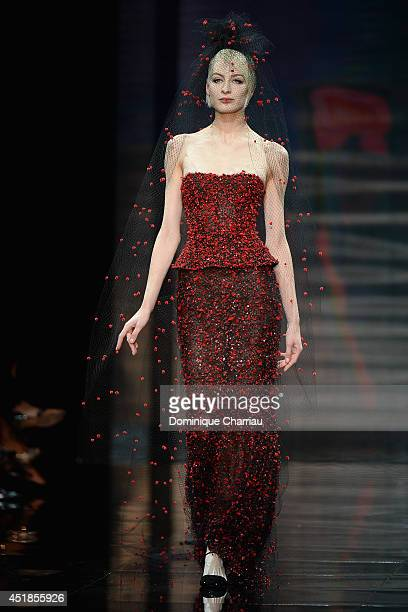 A model walks the runway at Giorgio Armani Prive show as part of Paris Fashion Week Haute Couture Fall/Winter 20142015 at Theatre National de...