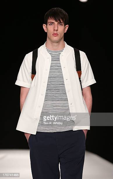 A model walks the runway at he YMC show during the London Collections MEN SS14 at The Old Sorting Office on June 17 2013 in London England
