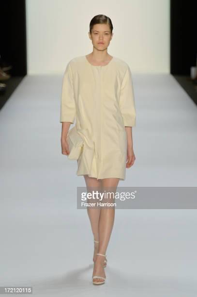 A model walks the runway at Hien Le Show during MercedesBenz Fashion Week Spring/Summer 2014 at Brandenburg Gateon July 2 2013 in Berlin Germany