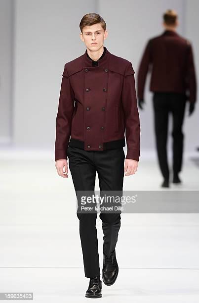 A model walks the runway at Hugo By Hugo Boss Autumn/Winter 2013/14 fashion show during MercedesBenz Fashion Week Berlin at Opernwerkstatte on...