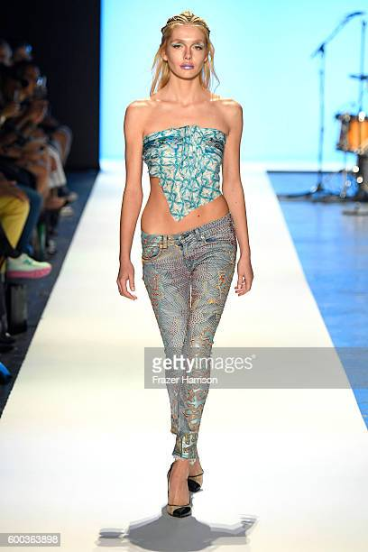 A model walks the runway at Jeans For Refugees By Johny Dar during New York Fashion Week The Shows September 2016 at The Arc Skylight at Moynihan...