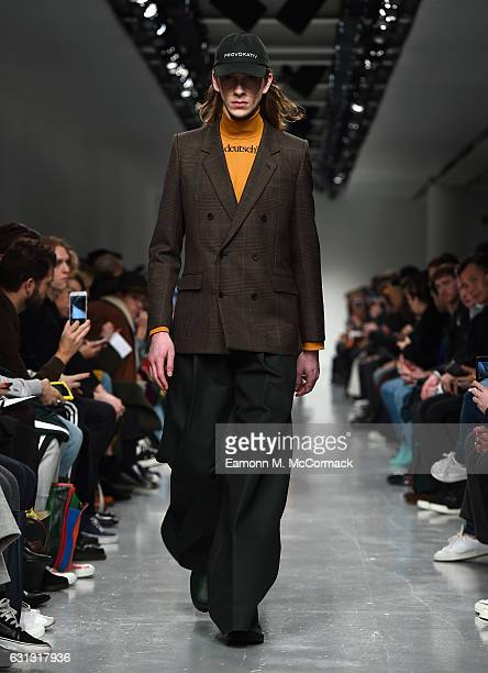 Model walks the runway at John Lawrence Sullivan during London Fashion Week Men's January 2017 collections at BFC Show Space on January 9, 2017 in...