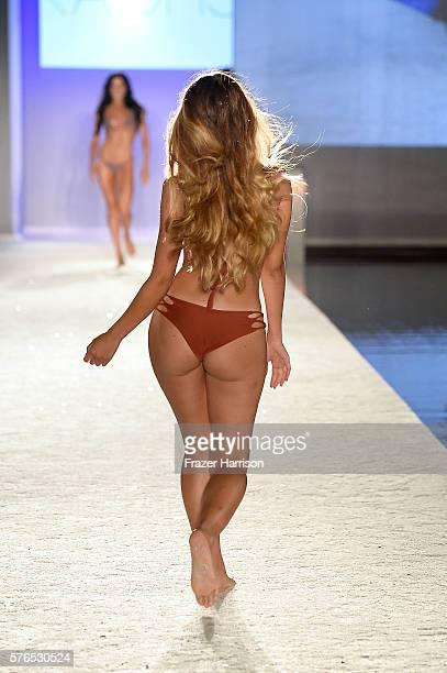 A model walks the runway at KAOHS 2017 Collection at SwimMiami Runway at W South Beach on July 15 2016 in Miami Beach Florida