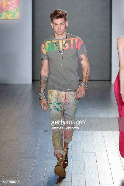 A model walks the runway at Kia STYLE360 Hosts Andy Hilfiger Presents ARTISTIX By Greg Polisseni S/S '18 at Metropolitan West on September 11 2017 in...