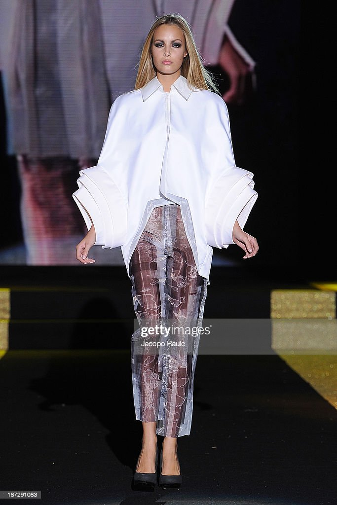 A model walks the runway at Kim Shui Fashion Show during the Mittelmoda Special Edition 2013 for Lectra on November 7, 2013 in Milan, Italy.