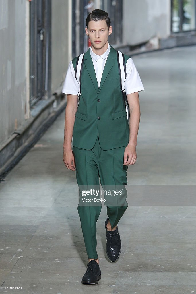 A model walks the runway at Krisvanassche Menswear Spring/Summer 2014 Show As Part Of The Paris Fashion Week on June 28, 2013 in Paris, France.