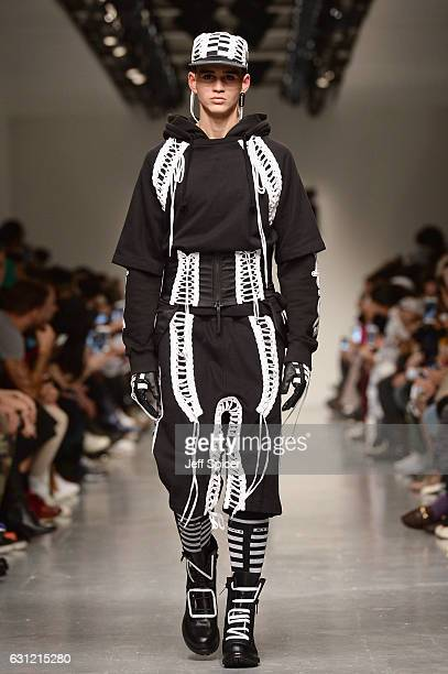 A model walks the runway at KTZ show during London Fashion Week Men's January 2017 collections at BFC Show Space on January 8 2017 in London England