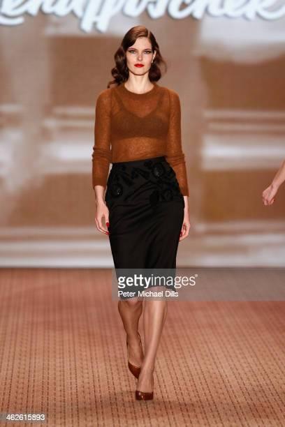 A model walks the runway at Lena Hoschek show during MercedesBenz Fashion Week Autumn/Winter 2014/15 at Brandenburg Gate on January 14 2014 in Berlin...