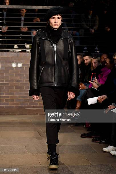 A model walks the runway at Maison MIHARA YASUHIRO show during London Fashion Week Men's January 2017 collections at Barbican Centre on January 8...