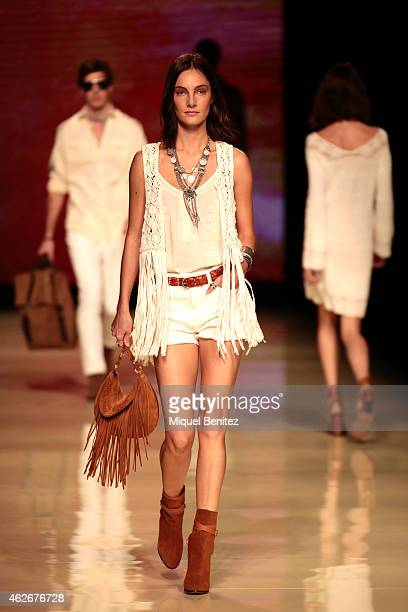 Model walks the runway at Mango's Collection during the ' 080 Barcelona Fashion Week Fall/Winter 15-16 at the Museum Maritim de Barcelona on February...