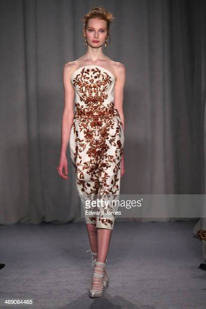 A model walks the runway at Marchesa during MercedesBenz Fashion Week Fall 2014 at New York Public Library on February 12 2014 in New York City