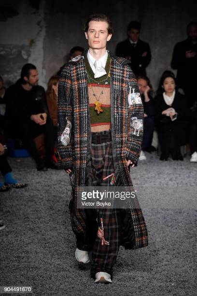 A model walks the runway at Marni show during Milan Men's Fashion Week Fall/Winter 2018/19 on January 13 2018 in Milan Italy