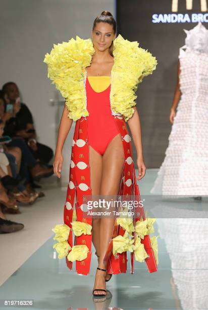 A model walks the runway at McDCouture Makes A Splash At Miami Swim Week at 2100 Collins Ave on July 20 2017 in Miami Florida McDonald's McDCouture...