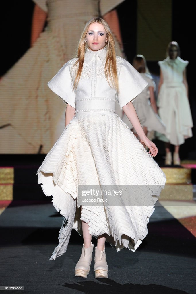 A model walks the runway at Mercedes Arocena and Lucia Benitez Fashion Show during the Mittelmoda Special Edition 2013 for Lectra on November 7, 2013 in Milan, Italy.