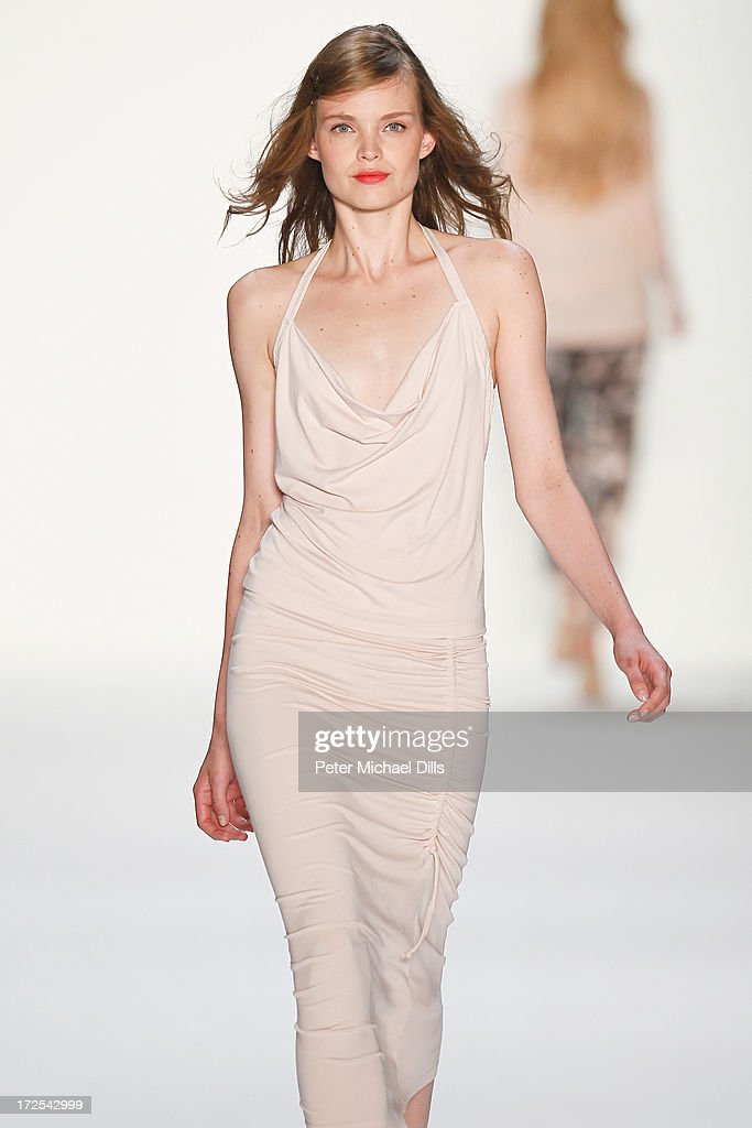 A model walks the runway at Minx By Eva Lutz show during Mercedes-Benz Fashion Week Spring/Summer 2014 at Brandenburg Gate on July 3, 2013 in Berlin, Germany.