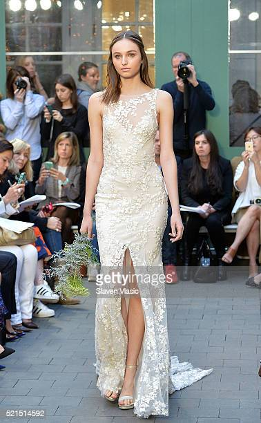 A model walks the runway at Monique Lhuillier Bridal Spring/Summer 2017 Runway Show at Laduree Soho on April 15 2016 in New York City