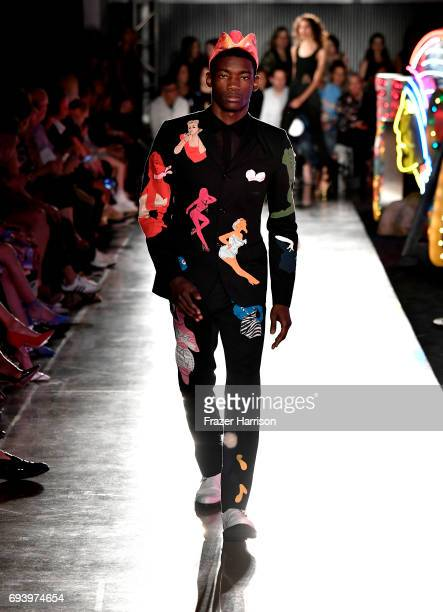 A model walks the runway at Moschino Spring/Summer 18 Menswear and Women's Resort Collection at Milk Studios on June 8 2017 in Hollywood California