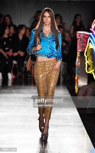 Model walks the runway at Moschino Spring/Summer 18 Menswear and Women's Resort Collection at Milk Studios on June 8 2017 in Hollywood California