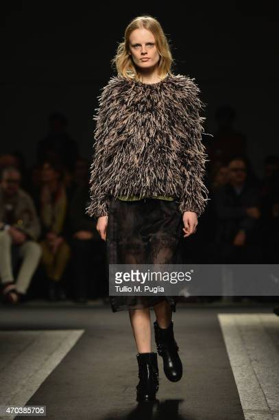 A model walks the runway at N 21 fashion show during Milan Fashion Week Womenswear Autumn/Winter 2014 on February 19 2014 in Milan Italy