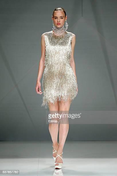 Model walks the runway at Naeem Khan bridal fashion Season 2017 show during 'Barcelona Bridal Fashion Week 2016' on April 27, 2016 in Barcelona,...
