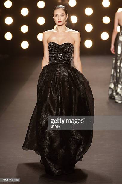A model walks the runway at Naeem Khan Fall 2014 Collection during MercedesBenz Fashion Week Fall 2014 at The Theatre at Lincoln Center on February...