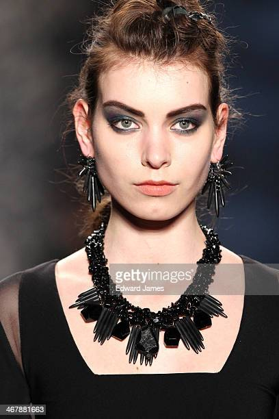 A model walks the runway at Nicole Miller during MercedesBenz Fashion Week Fall 2014 at The Salon at Lincoln Center on February 7 2014 in New York...