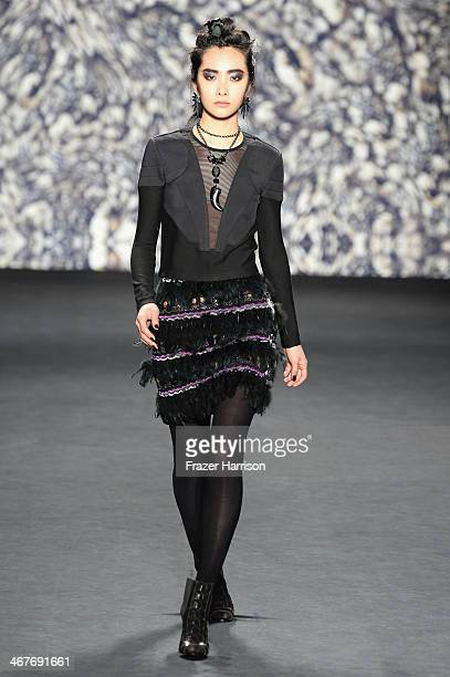 A model walks the runway at Nicole Miller fashion show during MercedesBenz Fashion Week Fall 2014 at Lincoln Center on February 7 2014 in New York...