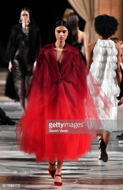 A model walks the runway at Oscar De La Renta fashion show during February 2018 New York Fashion Week at The Cunard Building on February 12 2018 in...