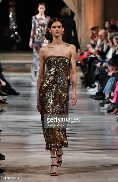 Model walks the runway at Oscar De La Renta fashion show during February 2018 New York Fashion Week at The Cunard Building on February 12, 2018 in...