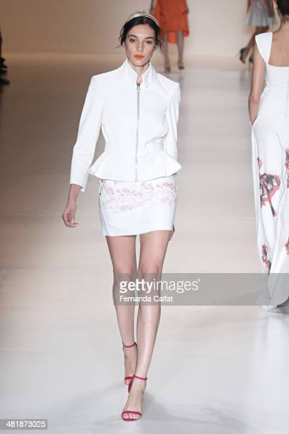 A model walks the runway at Patricia Motta show during Sao Paulo Fashion Week Summer 2014/2015 at Parque Candido Portinari on April 1 2014 in Sao...