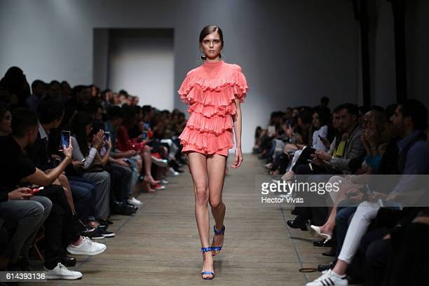 A model walks the runway at Pink Magnolia show the during MercedesBenz Fashion Week Mexico Spring/Summer 2017 at Rotativa el Universal on October 13...
