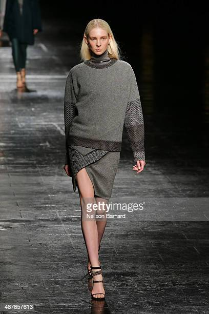 A model walks the runway at Prabal Gurung during MercedesBenz Fashion Week Fall 2014 at Skylight at Moynihan Station on February 8 2014 in New York...