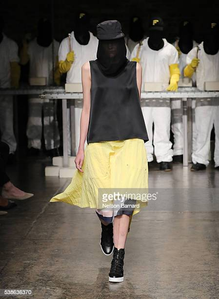 A model walks the runway at Public School's Women's and Men's Spring 2017 collection at Cedar Lake on June 7 2016 in New York City